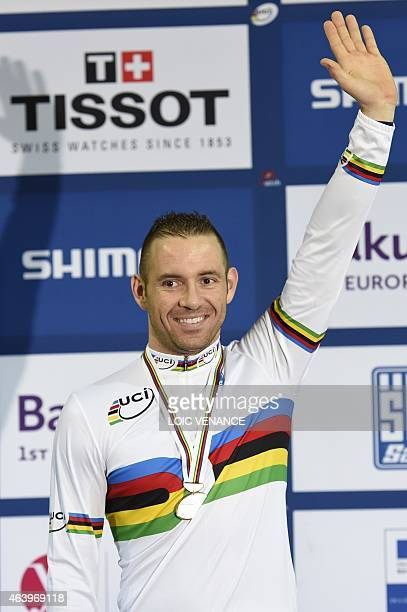 France's Francois Pervis celebrates on the podium after coming in first in the Men's Kilometre Time Trial Final at the UCI Track Cycling World...