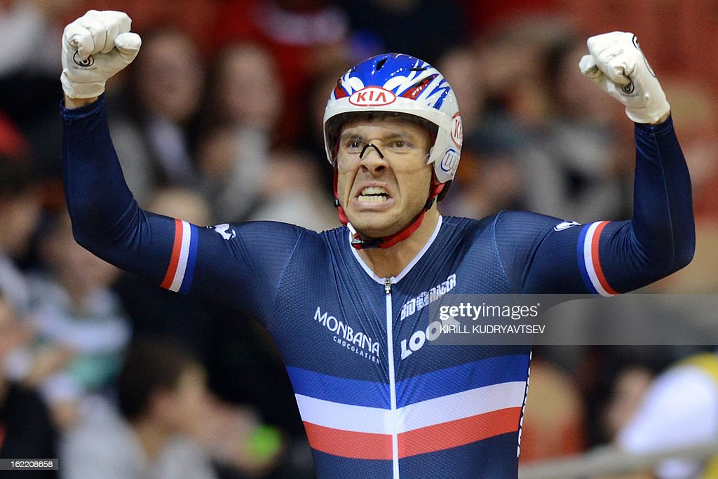 France's Francois Pervis celebrates winning the gold medal during the UCI Track Cycling World Championships men's time trial in Minsk on February 20, 2013.