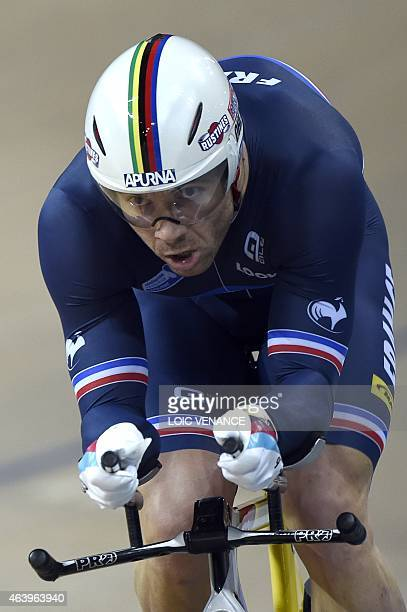 France's Francois Pervis competes to come in first in the Men's Kilometre time trial final at the UCI Track Cycling World Championships in...
