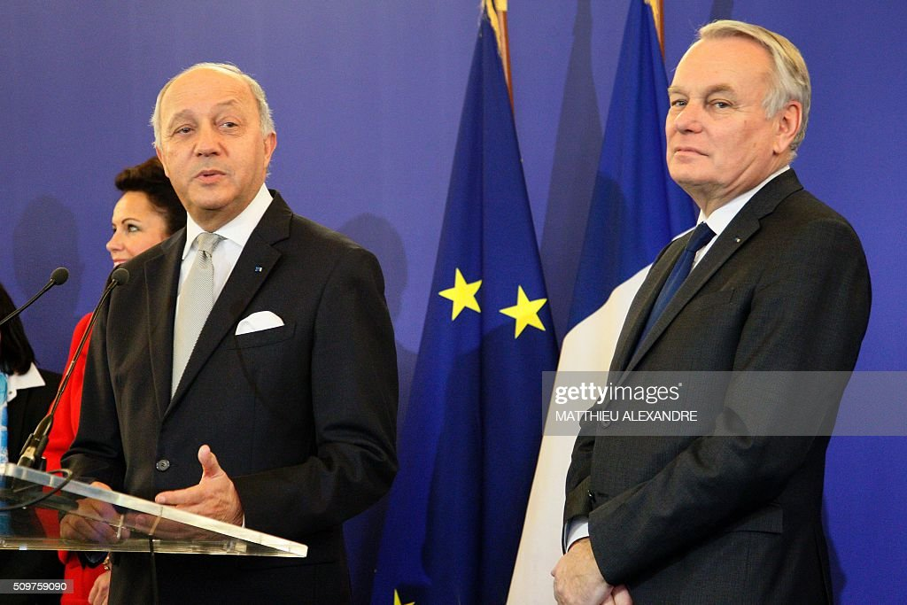 France's French Foreign Minister Laurent Fabius (L) speaks next to newly appointed French Foreign Minister Jean-Marc Ayrault on February 12, 2016 in Paris, during the handover ceremony. French President Francois Hollande reshuffled his cabinet on February 11, 2016, naming Jean-Marc Ayrault foreign minister and adding several ecologists to government as he seeks to widen his political base ahead of a presidential poll in 2017. ALEXANDRE