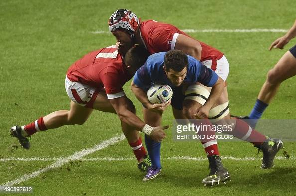France's fullback Brice Dulin is tackled by Canada's wing DTH van der Merwe and Canada's lock Jamie Cudmore during a Pool D match of the 2015 Rugby...