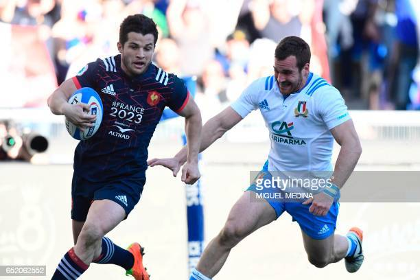 France's fullback Brice Dulin runs to score a try during the International Six Nations rugby union match Italy vs France on March 11 2017 at the...