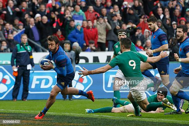 France's fullback Maxime Medard runs on his way to score the winning try during the Six Nations international rugby union match between France and...
