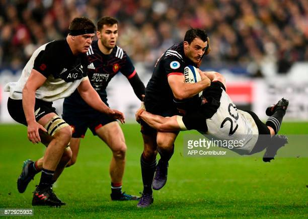 France's fullback Nans Ducuing is tackled by France's flanker Anthony Jelonch during the friendly rugby union international Test match between France...