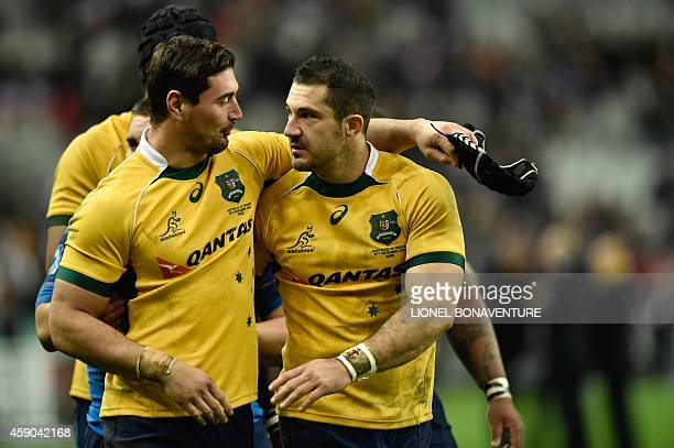France's fullback Scott Spedding and France's centre Alexandre Dumoulin both wearing Australia's jersey after exchanging them embrace after France...