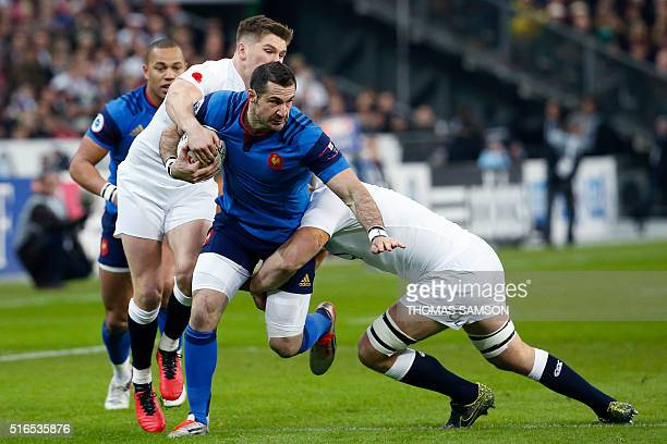 France's fullback Scott Spedding is tackled by England's centre Owen Farrell during the Six Nations international rugby union match between France...