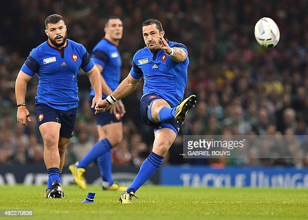 France's fullback Scott Spedding kicks the ball during a Pool D match of the 2015 Rugby World Cup between France and Ireland at the Millennium...