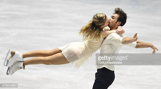 France's Gabriella Papadakis kisses Guillaume Cizeron perform during the free dance in the ice dance event at the ISU World Team Trophy figure...