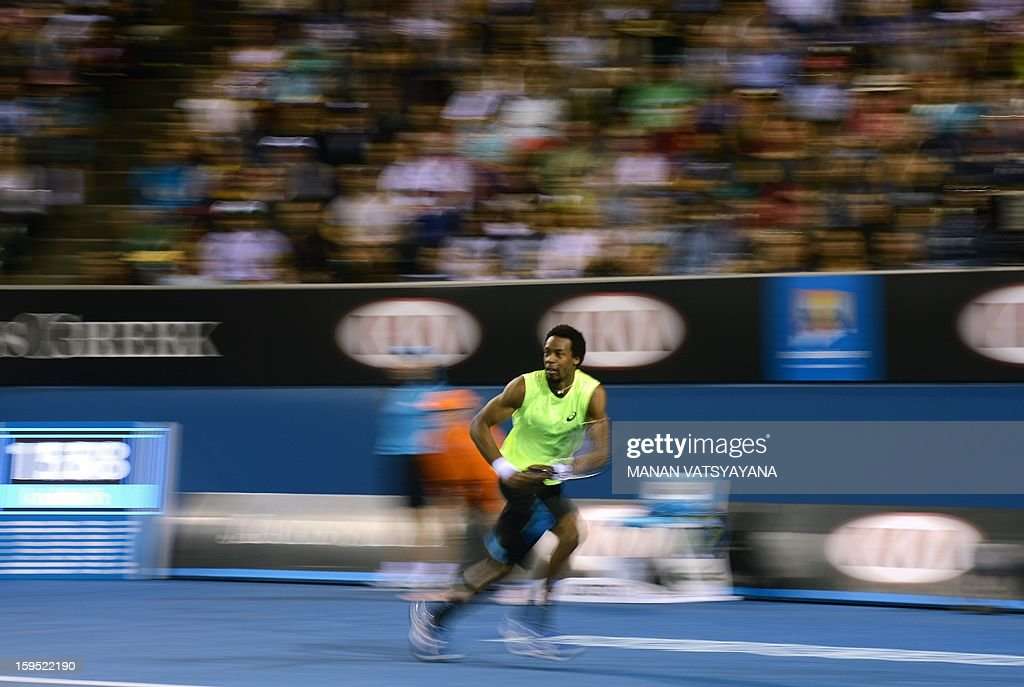 France's Gael Monfils competes against Ukraine's Alexandr Dolgopolov Jr. during their men's singles first round match on day two of the Australian Open tennis tournament in Melbourne on January 15, 2013.
