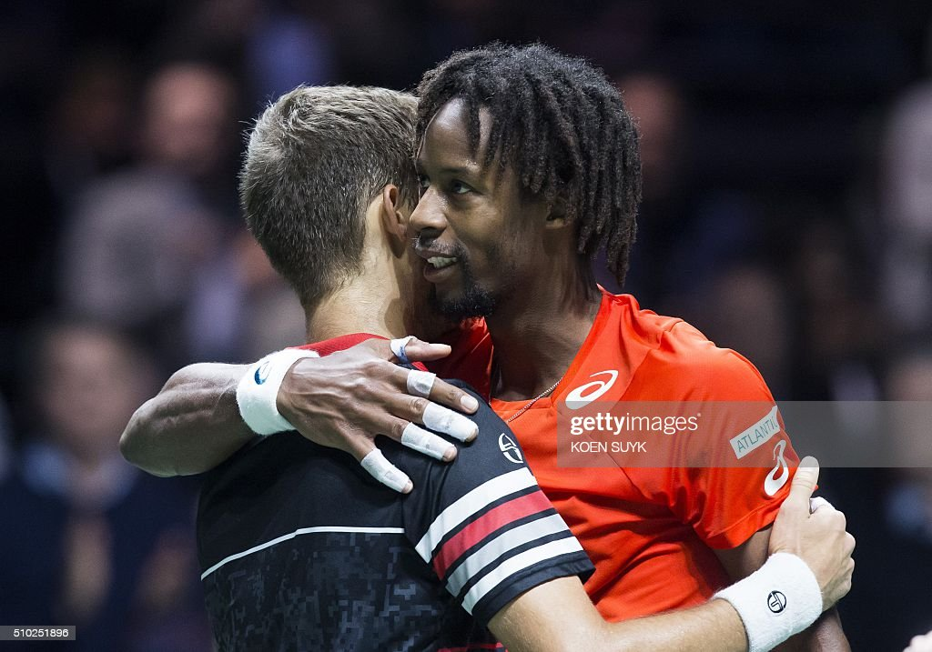 France's Gael Monfils embraces Martin Kliznan after being defeated in their ATP Rotterdam tournament final match, on February 14, 2016 in Rotterdam. / AFP / ANP / Koen Suyk / Netherlands OUT