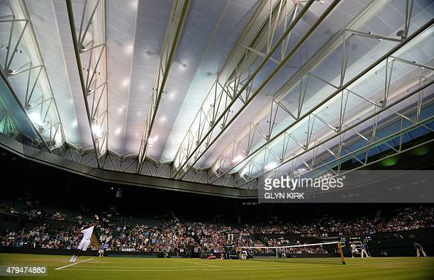 France's Gael Monfils France's Gilles Simon during their men's singles third round on Centre Court on day six of the 2015 Wimbledon Championships at...
