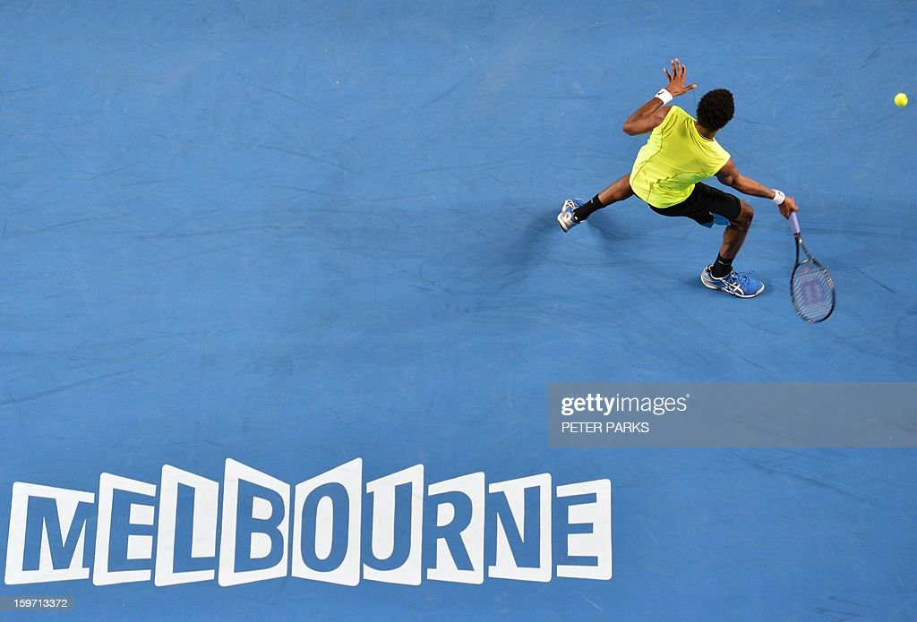 France's Gael Monfils hits a return against France's Gilles Simon during their men's singles match on day six of the Australian Open tennis tournament in Melbourne on January 19, 2013.