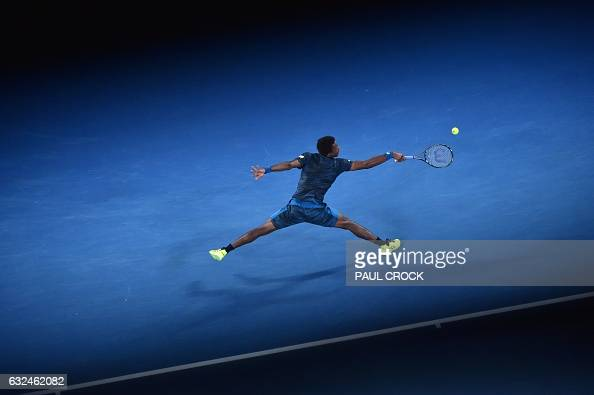 TOPSHOT France's Gael Monfils hits a return against Spain's Rafael Nadal during their men's singles fourth round match on day eight of the Australian...