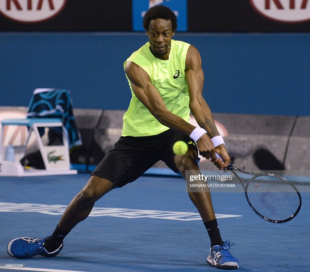 France's Gael Monfils hits a return against Ukraine's Alexandr Dolgopolov Jr. during their men's singles first round match on day two of the Australian Open tennis tournament in Melbourne on January 15, 2013.