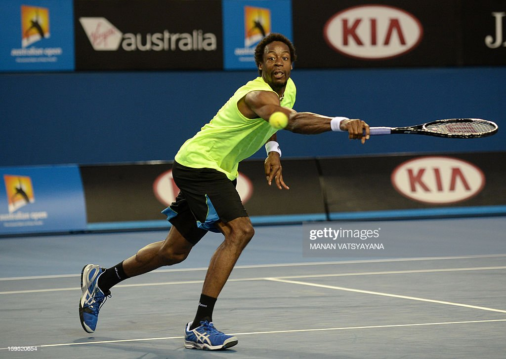 France's Gael Monfils plays a return during his men's singles match against Ukraine's Alexandr Dolgopolov on the second day of the Australian Open tennis tournament in Melbourne on January 15, 2013.