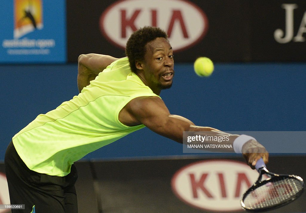 France's Gael Monfils plays a return during his men's singles match against Ukraine's Alexandr Dolgopolov on the second day of the Australian Open tennis tournament in Melbourne on January 15, 2013. AFP PHOTO/MANAN VATSYAYANA IMAGE STRICTLY RESTRICTED TO EDITORIAL USE - STRICTLY NO COMMERCIAL USE