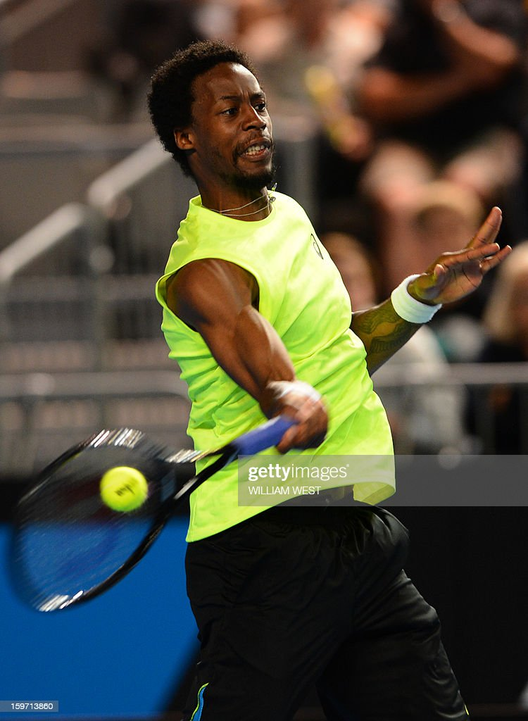 France's Gael Monfils plays a return during his men's singles match against compatriot Gilles Simon on the sixth day of the Australian Open tennis tournament in Melbourne on January 19, 2013.