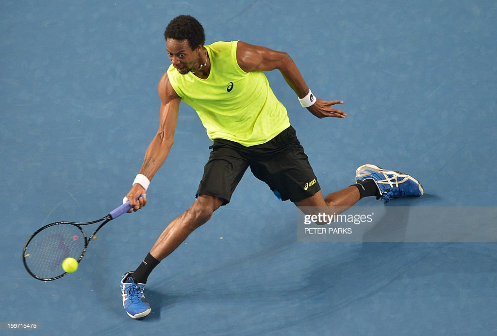 France's Gael Monfils plays a return during his men's singles match against compatriot Gilles Simon on the sixth day of the Australian Open tennis tournament in Melbourne early January 20, 2013.