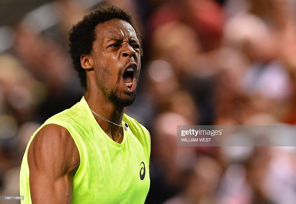 France's Gael Monfils reacts after a point against France's Gilles Simon during their men's singles match on day six of the Australian Open tennis tournament in Melbourne on January 19, 2013. AFP PHOTO / WILLIAM WEST IMAGE STRICTLY RESTRICTED TO EDITORIAL USE - STRICTLY NO COMMERCIAL USE