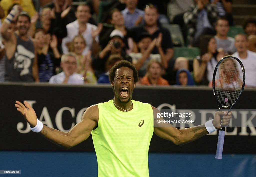 France's Gael Monfils reacts after winning a point during his men's singles match against Ukraine's Alexandr Dolgopolov on the second day of the Australian Open tennis tournament in Melbourne on January 15, 2013.