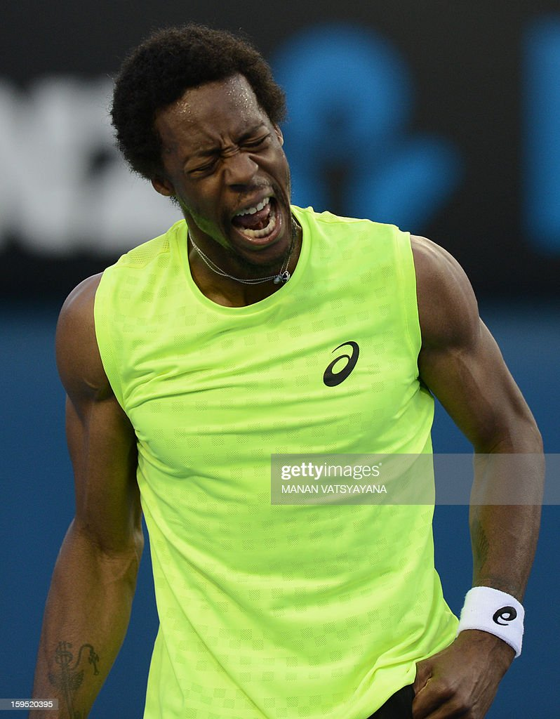 France's Gael Monfils reacts during his men's singles match against Ukraine's Alexandr Dolgopolov on the second day of the Australian Open tennis tournament in Melbourne on January 15, 2013.