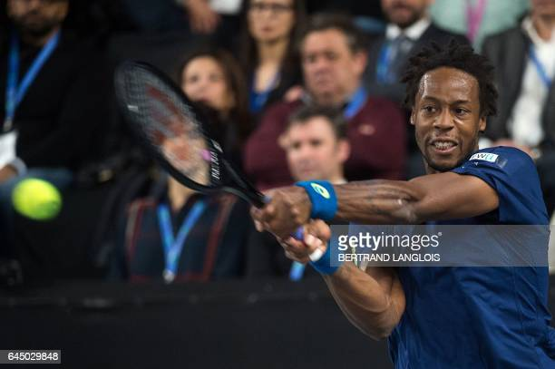 France's Gael Monfils returns the ball to France's Richard Gasquet during the ATP Marseille Open 13 tennis match in Marseille southern France on...