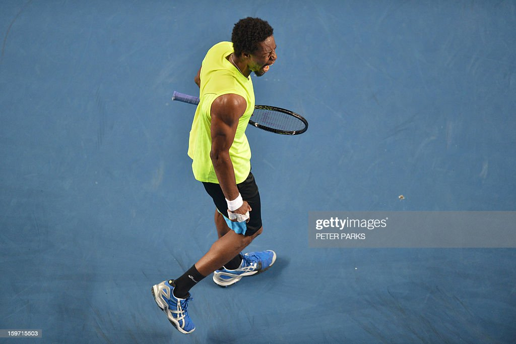 France's Gael Monfils shouts during his men's singles match against compatriot Gilles Simon on the sixth day of the Australian Open tennis tournament in Melbourne early January 20, 2013.