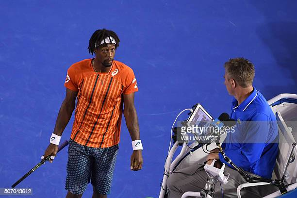 France's Gael Monfils speaks with umpire John Blom during his men's singles match against Canada's Milos Raonic on day ten of the 2016 Australian...
