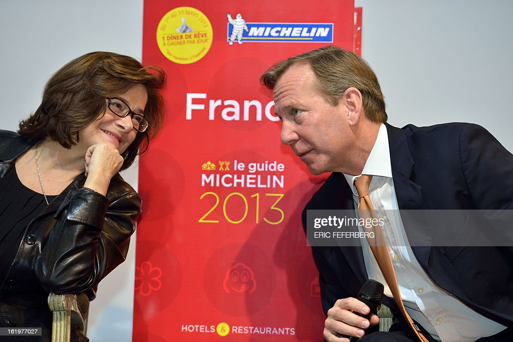 France's gastronomy bible, the Michelin Guide, executive comitee member Claire Dorland-Clauzel, talks with the international director Michael Ellis during the presentation of the 2013 edition of the famous gastronomic guide on February 18, 2013 in Paris. the Michelin Guide awarded today its coveted three-star rating to 35-year-old chef Arnaud Donckele for his cuisine celebrating the Mediterranean and sunny Provence. AFP/PHOTO ERIC FEFERBERG
