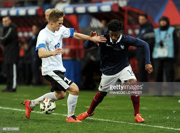 France's GeorgesKevin N'Koudou vies with Estonia' Martin Magi during a friendly Under 21 football match between France and Estonia on March 25 2015...