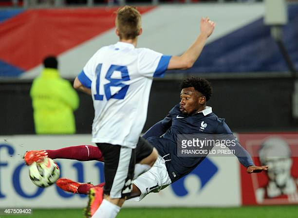 France's GeorgesKevin N'Koudou vies with Estonia's Martin Magi during a friendly Under 21 football match between France and Estonia on March 25 2015...