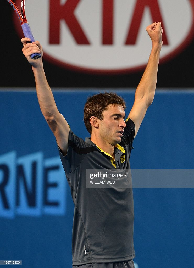 France's Gilles Simon celebrates after beating France's Gael Monfils during their men's singles match on day six of the Australian Open tennis tournament in Melbourne on January 19, 2013.
