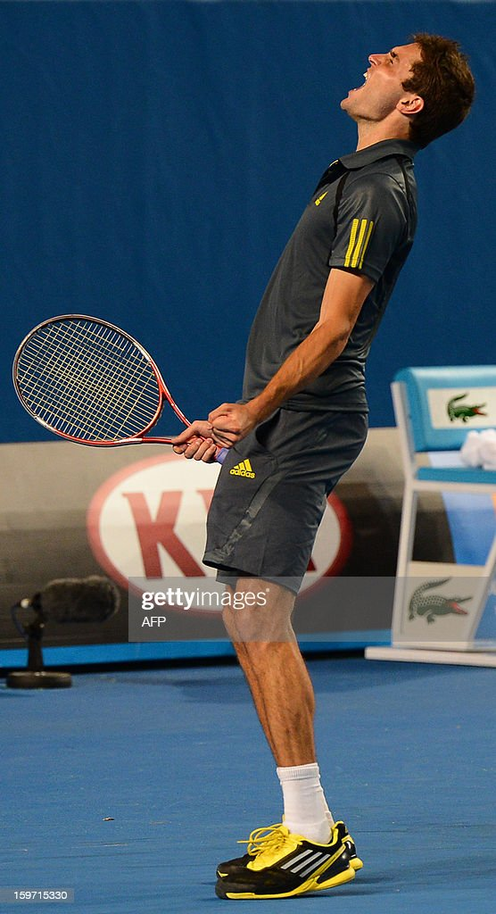 France's Gilles Simon celebrates after victory in his men's singles match against compatriot Gael Monfils on the sixth day of the Australian Open tennis tournament in Melbourne on January 19, 2013.