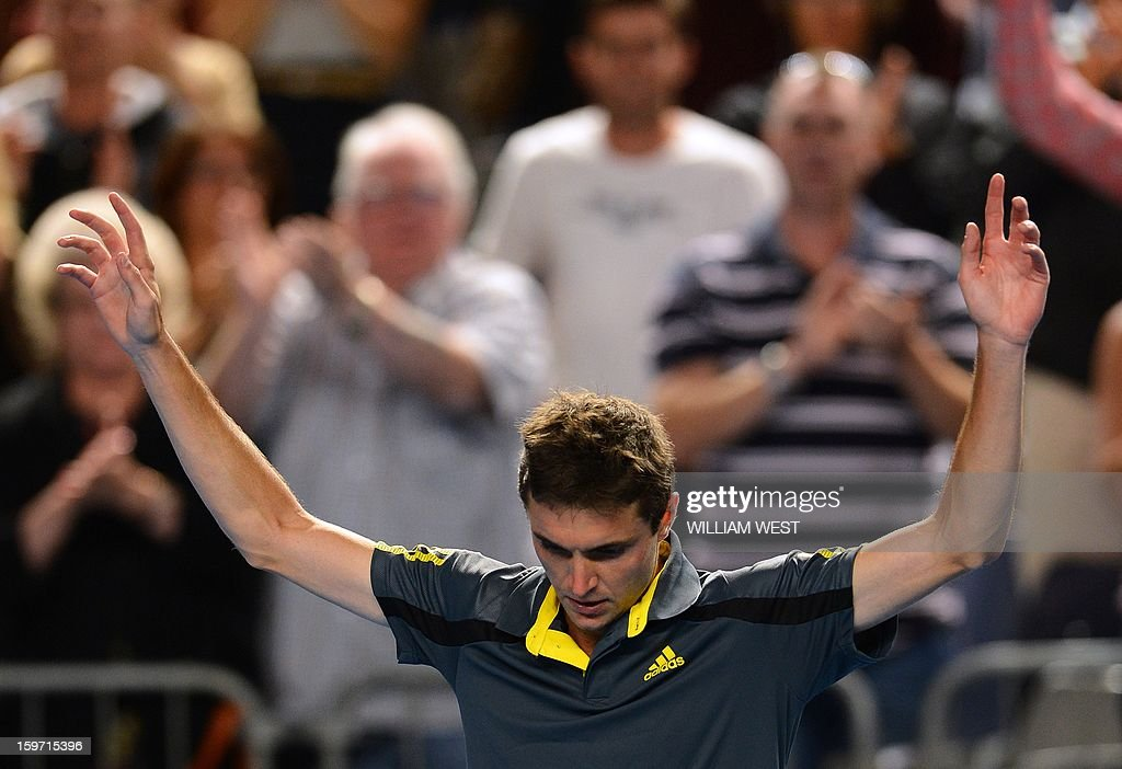 France's Gilles Simon celebrates victory during a men's singles match against France's Gael Monfils on day six of the Australian Open tennis tournament in Melbourne early on January 20, 2013. AFP PHOTO / WILLIAM WEST IMAGE STRICTLY RESTRICTED TO EDITORIAL USE - STRICTLY NO COMMERCIAL USE