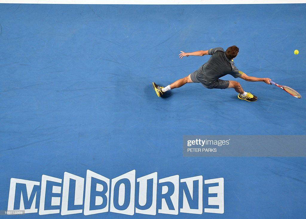 France's Gilles Simon hits a return against France's Gael Monfils during their men's singles match on day six of the Australian Open tennis tournament in Melbourne on January 19, 2013.