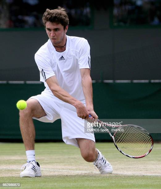 France's Gilles Simon in action against France's Richard Gasquet