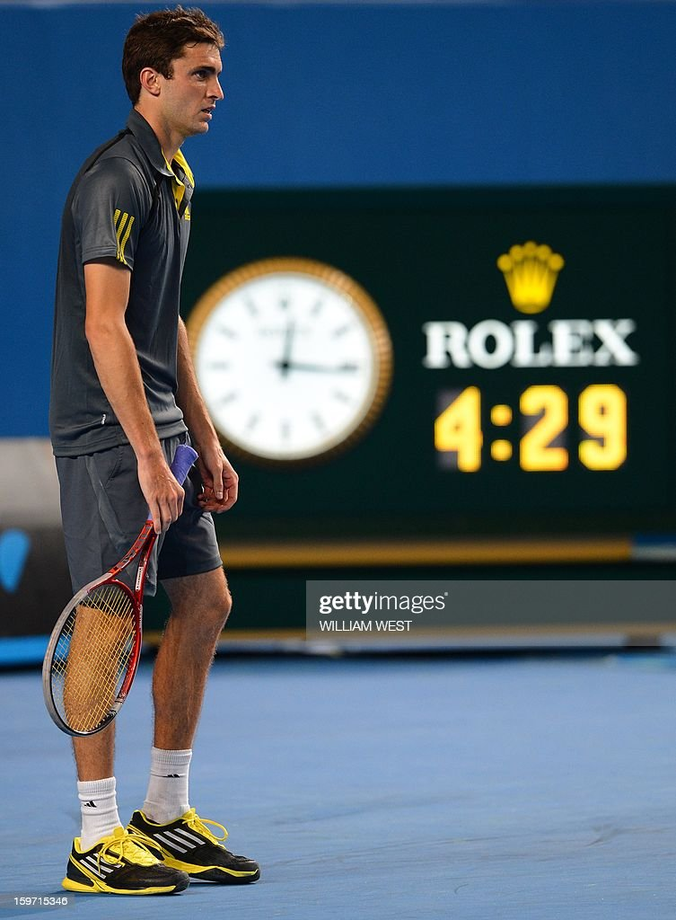 France's Gilles Simon looks on in his men's singles match against France's Gael Monfils on day six of the Australian Open tennis tournament in Melbourne early on January 20, 2013.