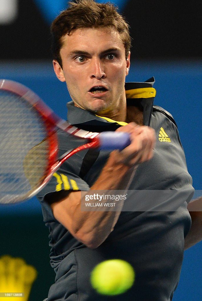 France's Gilles Simon plays a return during his men's singles match against compatriot Gael Monfils on the sixth day of the Australian Open tennis tournament in Melbourne on January 19, 2013. AFP PHOTO/WILLIAM WEST IMAGE STRICTLY RESTRICTED TO EDITORIAL USE - STRICTLY NO COMMERCIAL USE
