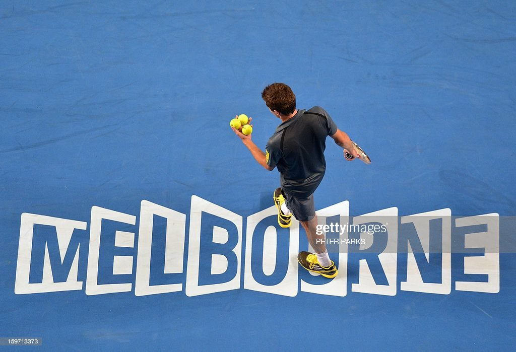 France's Gilles Simon prepares to serve against France's Gael Monfils during their men's singles match on day six of the Australian Open tennis tournament in Melbourne on January 19, 2013.