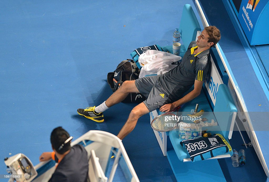 France's Gilles Simon rests after victory in his men's singles match against compatriot Gael Monfils on the sixth day of the Australian Open tennis tournament in Melbourne on January 19, 2013. AFP PHOTO/PETER PARKS IMAGE STRICTLY RESTRICTED TO EDITORIAL USE - STRICTLY NO COMMERCIAL USE