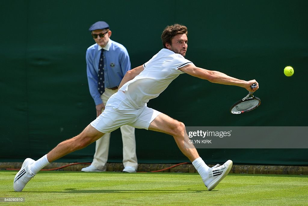 France's Gilles Simon returns against Serbia's Janko Tipsarevic during their men's singles first round match on the first day of the 2016 Wimbledon Championships at The All England Lawn Tennis Club in Wimbledon, southwest London, on June 27, 2016. / AFP / GLYN