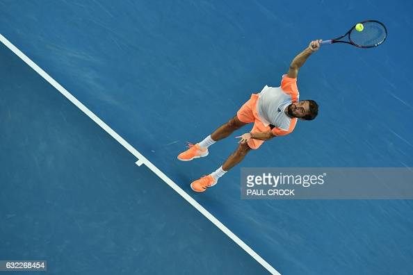 TOPSHOT France's Gilles Simon serves against Canada's Milos Raonic during their men's singles third round match on day six of the Australian Open...