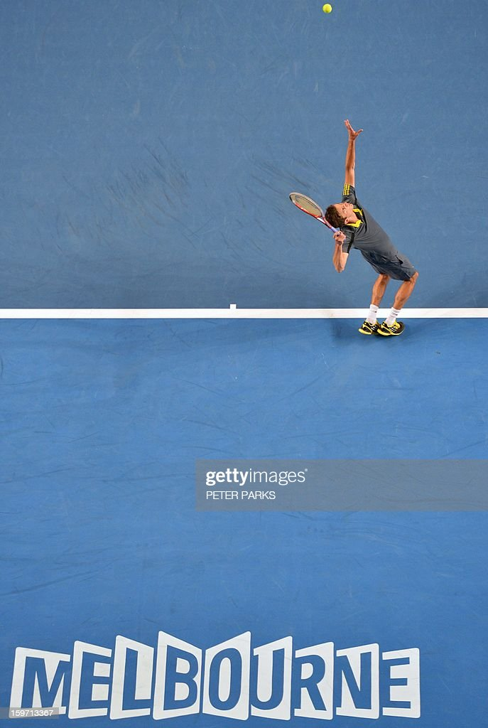 France's Gilles Simon serves against France's Gael Monfils during their men's singles match on day six of the Australian Open tennis tournament in Melbourne on January 19, 2013.