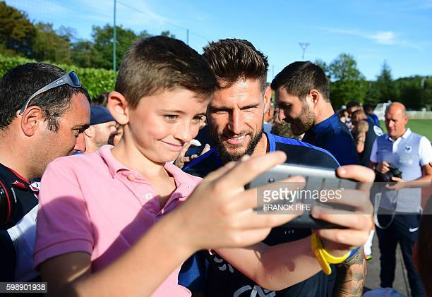 France's goalkeeper Benoit Costil poses for a photo during a training session in ClairefontaineenYvelines near Paris on September 3 2016 France will...