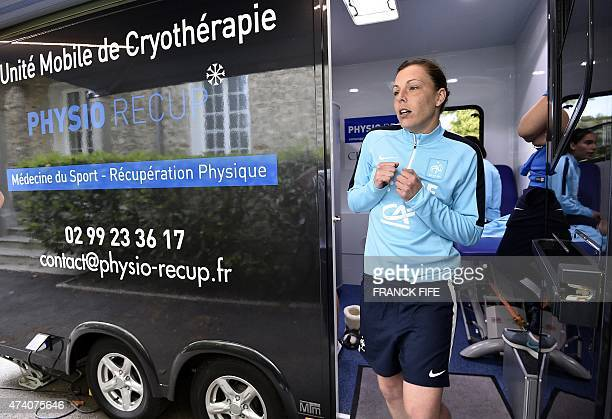 France's goalkeeper Celine Deville leaves a medical device used for cryotherapy at at the French national football team training base in...