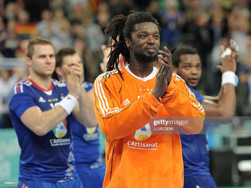 France's goalkeeper Daouda Karaboue applauds after the 23rd Men's Handball World Championships preliminary round Group A match France vs Germany at the Palau Sant Jordi in Barcelona on January 18, 2013. Germany won 32-30.
