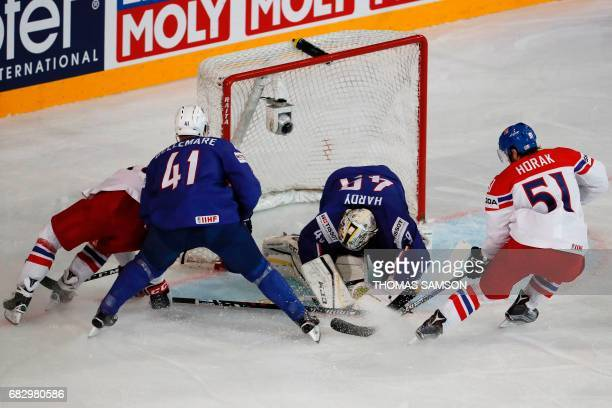France's goalkeeper Florian Hardy stops a goal during the IIHF Men's World Championship group B ice hockey match between France and Czech Republic in...
