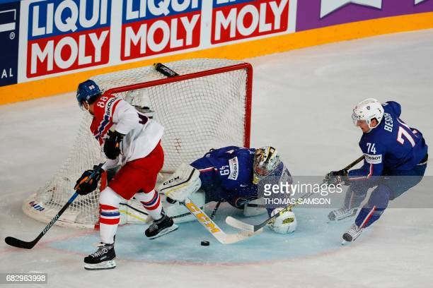France's goalkeeper Florian Hardy stops the puck during the IIHF Men's World Championship group B ice hockey match between France and Czech Republic...
