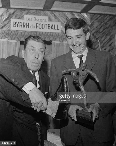 France's goalkeeper Georges Carnus receives an award from actor Fernandel