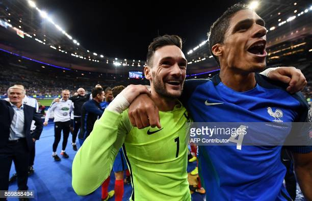 France's goalkeeper Hugo Lloris and France's defender Raphael Varane celebrate after winning the FIFA World Cup 2018 qualification football match...